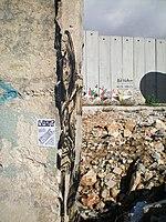 Bethlehem wall graffiti by Swoon and Lost sticker.jpeg