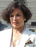 Bianca Jagger in a white jacket