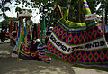 Bilums (Traditional bags from PNG) hang for sale from a tree in Honiara. Front of image is a bag that reads 'Solomon Islands' with a price tag. (10677379183).jpg