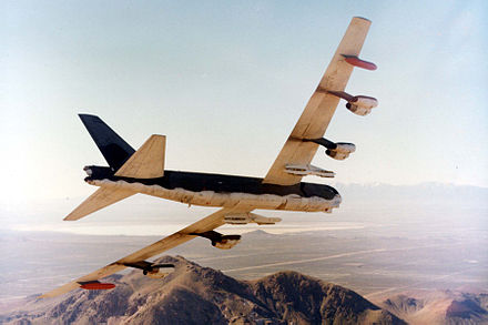 A B-52G in flight. Note the external wing pylons and larger bomb bays to accommodate conventional bombs - Wurtsmith Air Force Base