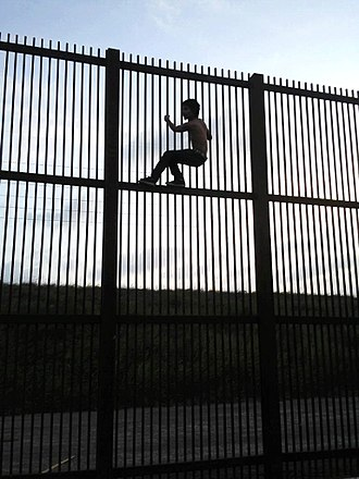 Mexico–United States border - Climbing the Mexico–United States barrier fence in Brownsville, Texas