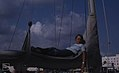 Boy on furled sail of ship (38154672194).jpg
