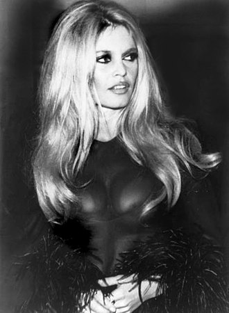 Costa del Sol - Brigitte Bardot, one of the first to introduce the practice of toplessness, enjoying the nightlife in 1958.