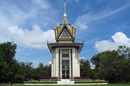 Choeung Ek, a known site of mass grave for genocide victims during the Khmer Rouge era Buddhist Stupa at Choeung Ek killing fields, Cambodia.JPG