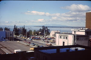 History of Anchorage, Alaska - 1976 view from the Hotel Captain Cook, showing the northwest corner of downtown Anchorage and Knik Arm.  The parking lot at left foreground was replaced with a parking garage shortly after this photo was taken.