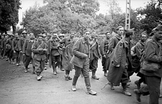 French prisoners of war in World War II - French prisoners of war being marched away from the front, May 1940
