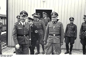 Franz Josef Huber - Franz Josef Huber (in doorway) with Heinrich Himmler, August Eigruber and other SS officers, at Mauthausen-Gusen concentration camp, June 1941.