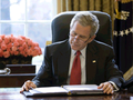 Bush at desk reading SotU draft.png