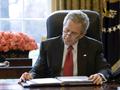 Bush at desk reading SotU draft.png