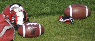 Canadian football - Footballs and a helmet at a Calgary Stampeders (CFL) team practice