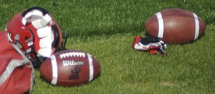Footballs and a helmet at a Calgary Stampeders (CFL) team practice CFL footballs and helmet.jpg