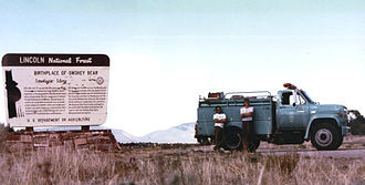 Smokey Bear - Tahoe National Forest Fire Engine 731 and Crew at Smokey Bear Vista Point in June 1990 (Temporarily assigned to Lincoln National Forest). Capitan Gap is the pass located in the distance between the Engine and the sign.