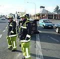 Car on side firemen attend.jpg