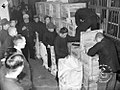 Carrying Cash in Republican China - Money being packed into large bags for transport to the customer.jpg