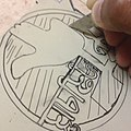 Carving A linoleum sheet for stamp-making.jpg