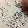 Carving A linoleum sheet for stamp-making.jpg