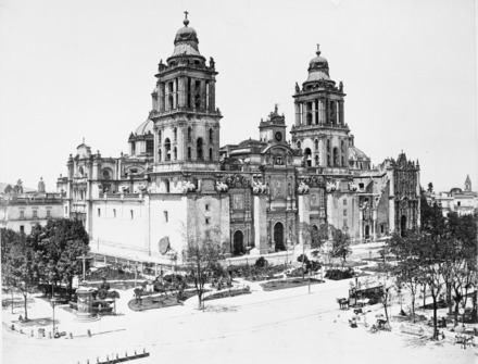 Cathedral, Mexico City, ca. 1880. Photo by Abel Briquet. Note the Aztec Calendar Stone up against the cathedral wall under the bell tower. Catedral Mexico 1880-1900.tif