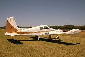 Cessna 310 - 1957 Cessna 310B, with straight fin and overwing augmentor tube exhaust system