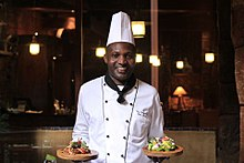 Chef Tom Wandera at work.jpg