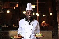 Chef Tom Wandera at work.jpg