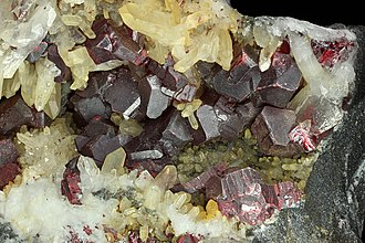 Cinnabar - Cinnabar crystals of an individual size of one centimeter, on quartz. Almadén (Ciudad Real) Spain. Coll. Museum of the School of Mining Engineers of Madrid.