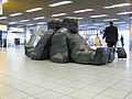 Claassen Schiphol Sitting Men 02.jpg