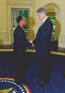 Aristide in un incontro con Bill Clinton