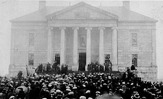 People in front of the Colonial Building protesting economic conditions, 1932. In the next year, the government of Newfoundland collapsed, and the British government resumed direct control over Newfoundland. Colonial riot 500.jpg