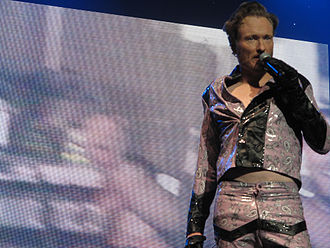 Conan O'Brien - O'Brien performing in a replica of the costume Eddie Murphy wore in Eddie Murphy Raw (2010).