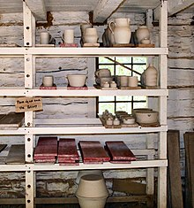 unfired green ware pottery on a traditional drying rack at conner prairie living history museum