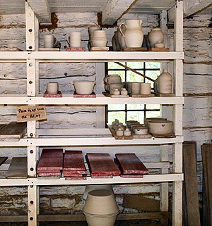 "Pottery - Unfired ""green ware"" pottery on a traditional drying rack at Conner Prairie living history museum"