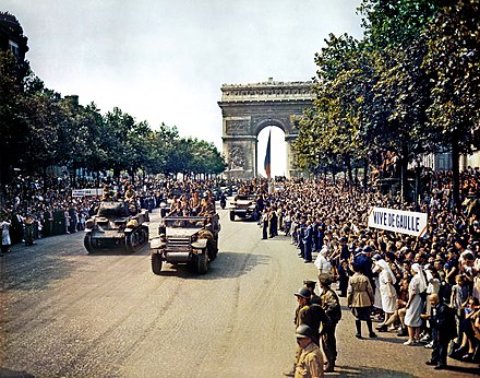 Crowds of French people line the Champs Elysees following the Liberation of Paris, 26 August 1944 Crowds of French patriots line the Champs Elysees-edit2.jpg