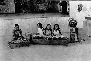Culion leper colony - Members of the Culion leper colony in an undated photograph. The women in the center appear to be playing the kulintang traditional instrument.