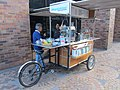 Custom bike coffee cart, Quito, back end, right side view,Modern Building in Quito, capital city of Ecuador, and at an elevation of 2,850 metres (9,350 ft) above sea level.jpg