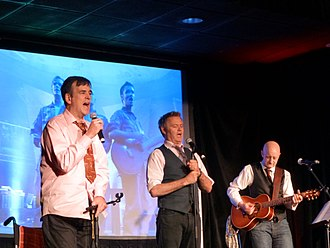 Tim Ferguson - Ferguson (left) performing with the reformed Doug Anthony All Stars in 2014.