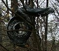 Damaged airplane tyre in tree (detail).jpg
