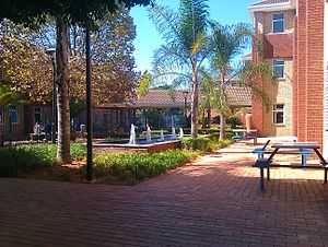 Damelin - The entrance of the Damelin Randburg campus with the main building on the right.
