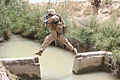 Defense.gov News Photo 100705-M-5207F-074 - A U.S. Marine with Weapons Company 3rd Battalion 1st Marine Regiment Regimental Combat Team 7 patrols back to Patrol Base Gorgak after a.jpg