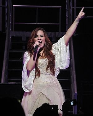 "Demi Lovato: Stay Strong - Lovato performing in the dress she wore when she let the ""special"" fan on stage, December 2011."