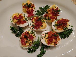 Deviled eggs Deviled eggs with bacon, garnished with parsly