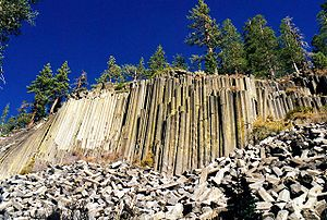 Devils Postpile National Monument - The longer fragments of basalt at the base of the cliff are much larger than a person.