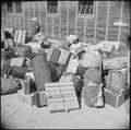 Eden, Idaho. Baggage, belonging to the evacuees from the assembly center at Puyallup, Washington, i . . . - NARA - 538276.tif