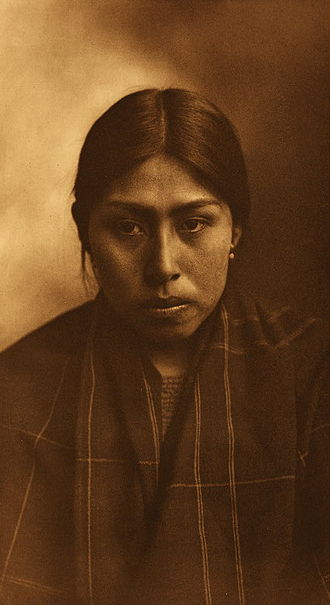 Suquamish - Suquamish woman photographed by Edward S. Curtis in 1913.