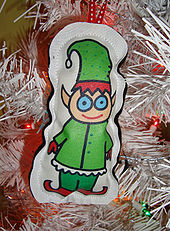 An image of a modern Christmas elf on a Christmas tree decoration.