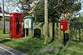Elizabeth II post box K6 telephone box and utility poles Little Laver Road Essex England.jpg