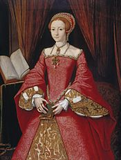 Painting of a woman with red hair holding a book and wearing an elaborate red dress with jewelry. A book on a stand and drapery appear in the background.