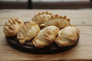 Empanada Baked or fried turnover consisting of pastry and filling