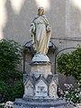 Espalion statue devant église (2).jpg