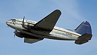 Everts Air Cargo C-46 leaving ANC for the Bush (6479960089).jpg