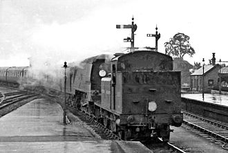 LB&SCR E1 class - E1/R 0-6-2T No. 32124 piloting a Bulleid Light Pacific at Exeter St David's 16 July 1949